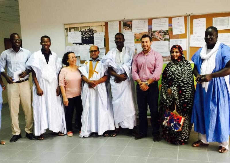 صورة جماعية لطاقم الجامعة اللبنانية وأعضاء من لجنة دعم الشاعر محمد إدوم (السراج)