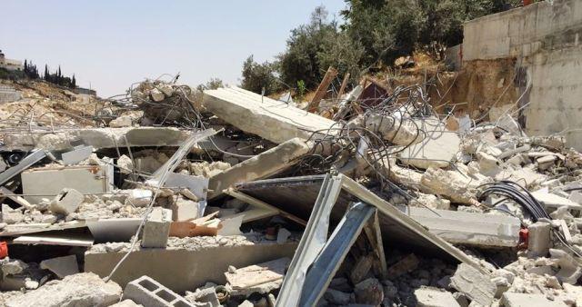 صورة عملية هدم (المركز الفلسطيني للإعلام)