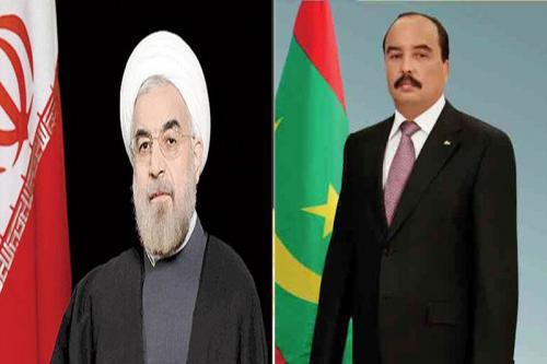 الرئيسان الموريتاني محمد ولد عبد العزيز والإيراني حسن روحاني.