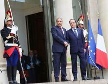 لقاء سابق بين رئيس موريتانيا محمد ولد عبد العزيز والرئيس الفرنسي فرانسوا هولاند (أرشيف)