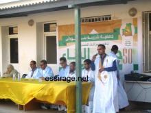 يظهر في الصورة صاحب الربط ثم رئيس الجمعية فإمام ثم ممثل مندوبية الشباب ثم العمدة ورئيس المخيم ومديرة المدرسة