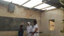 الوفد في بقايا إحدي المدارس