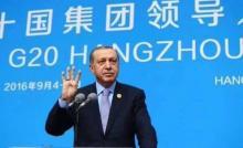 """أردوغان يرفع شارة """"رابعة"""" في ختام قمة العشرين"""
